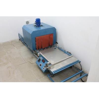 Urządzenie do pakowania w folię termokurczliwą